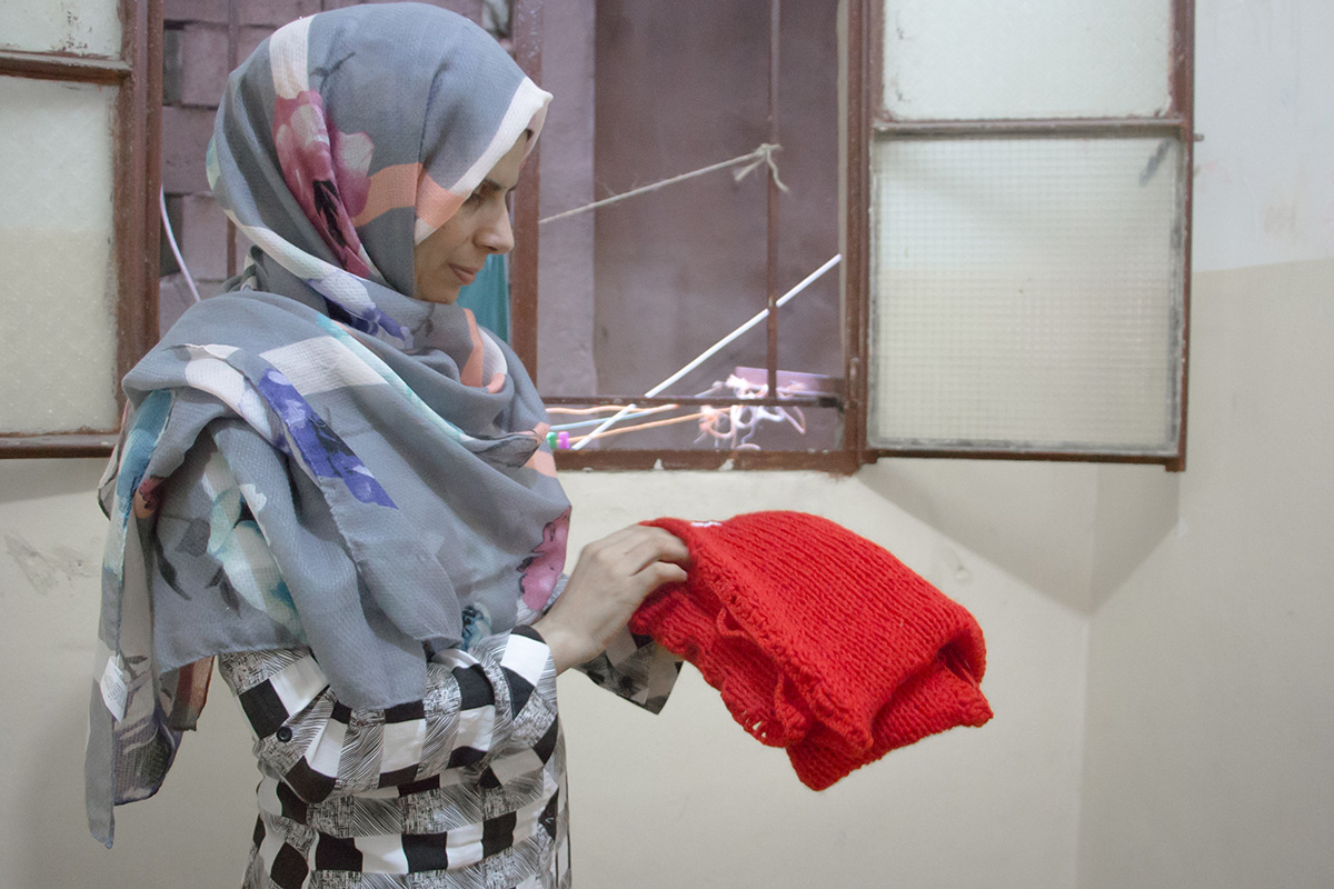 Malak holding one of the first Syrian Scarves. Photography by yours truly.