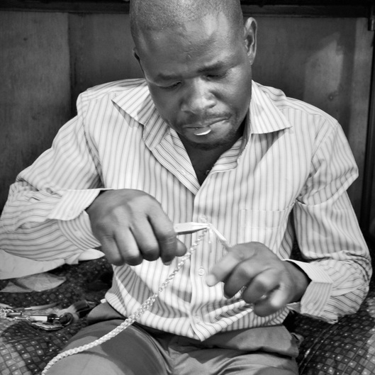 Artisan: Ojiko - Ojiko is an artisan from the Kenyan port town of Kisumu.Having picked up the art of jewelry making in 2006 from a local apprenticeship in Nairobi, Ojiko's biggest dream is to teach others to create jewelry that would, in turn, help his local community.Ojiko hand-forges each brass piece with care and expertise.