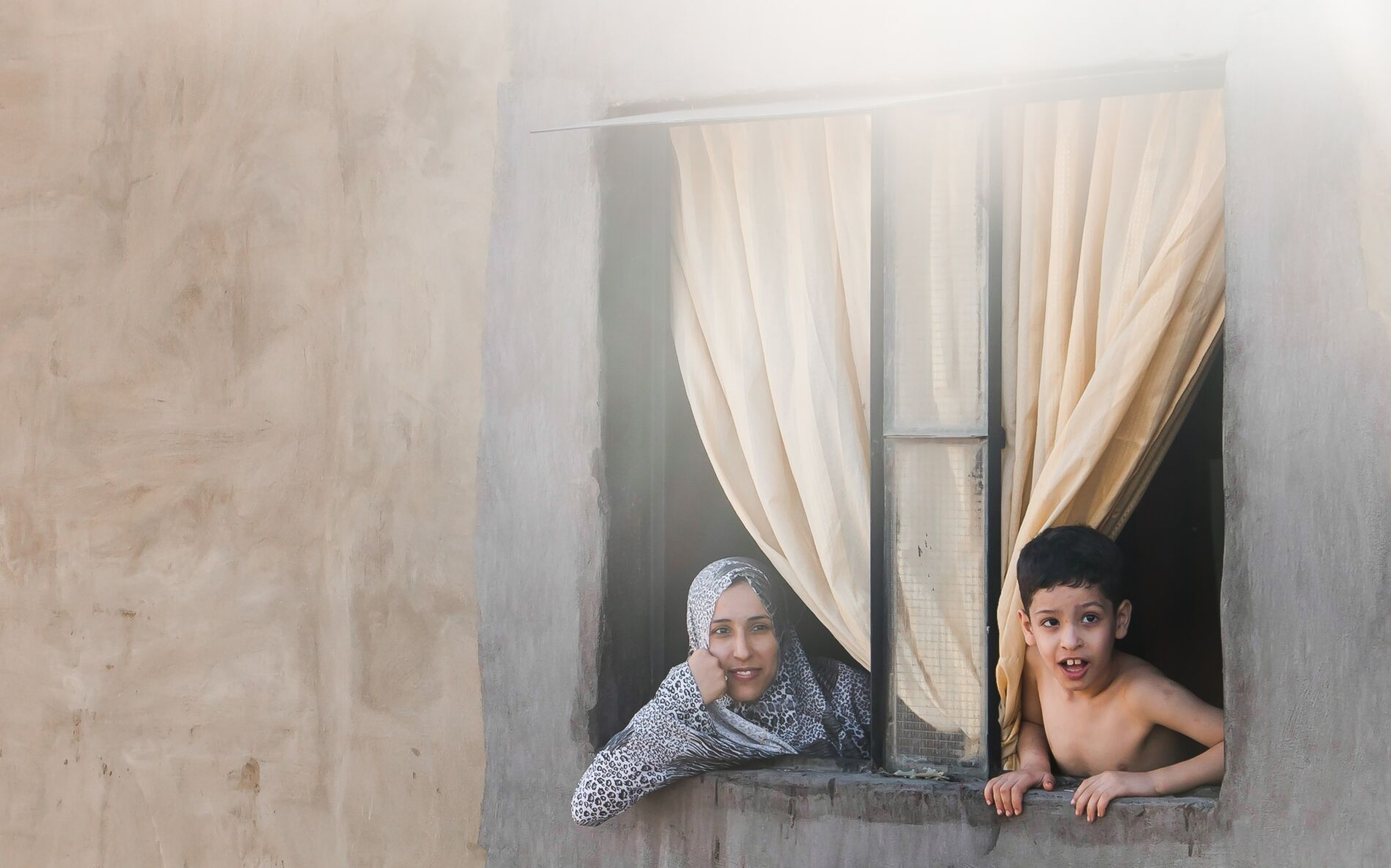 The artisan Ayush and her child in Chatila refugee settlement in Beirut, Lebanon.  Photograph by Artisan & Fox.