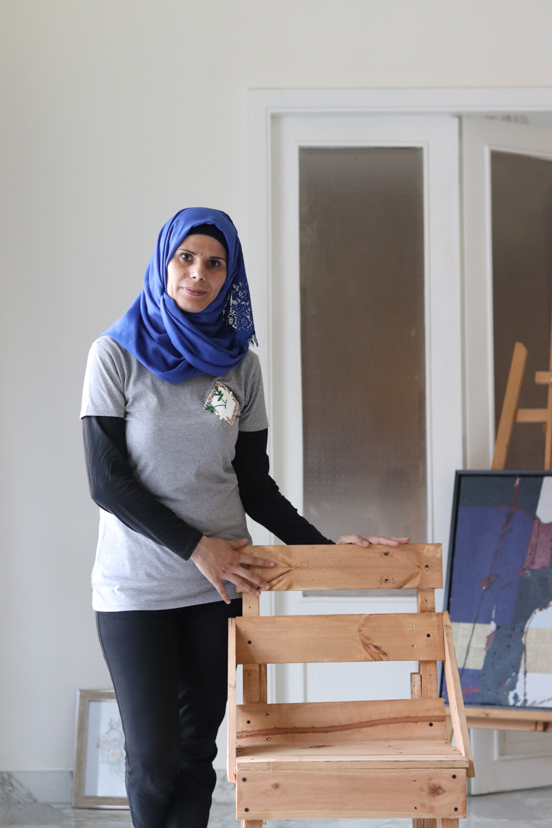 Malak, co-founder and field manager of the Tight-Knit Syria collective in the Shatila camp.