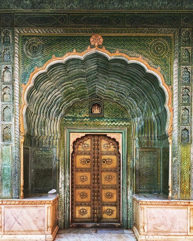 "📍City Palace, Jaipur. ""This doorway inside the inner courtyard of the City Palace has a wave-like pattern, and is dedicated to the Hindu God, Ganesha. The green is suggestive of the spring season."" Photography by @shrutisivakumar, via @worldnomads."