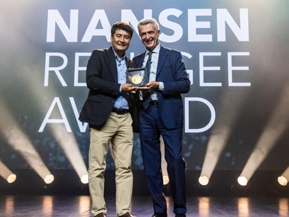 Ashurov being offered the award by UNHCR High Commissioner. Photo by UNHCR.