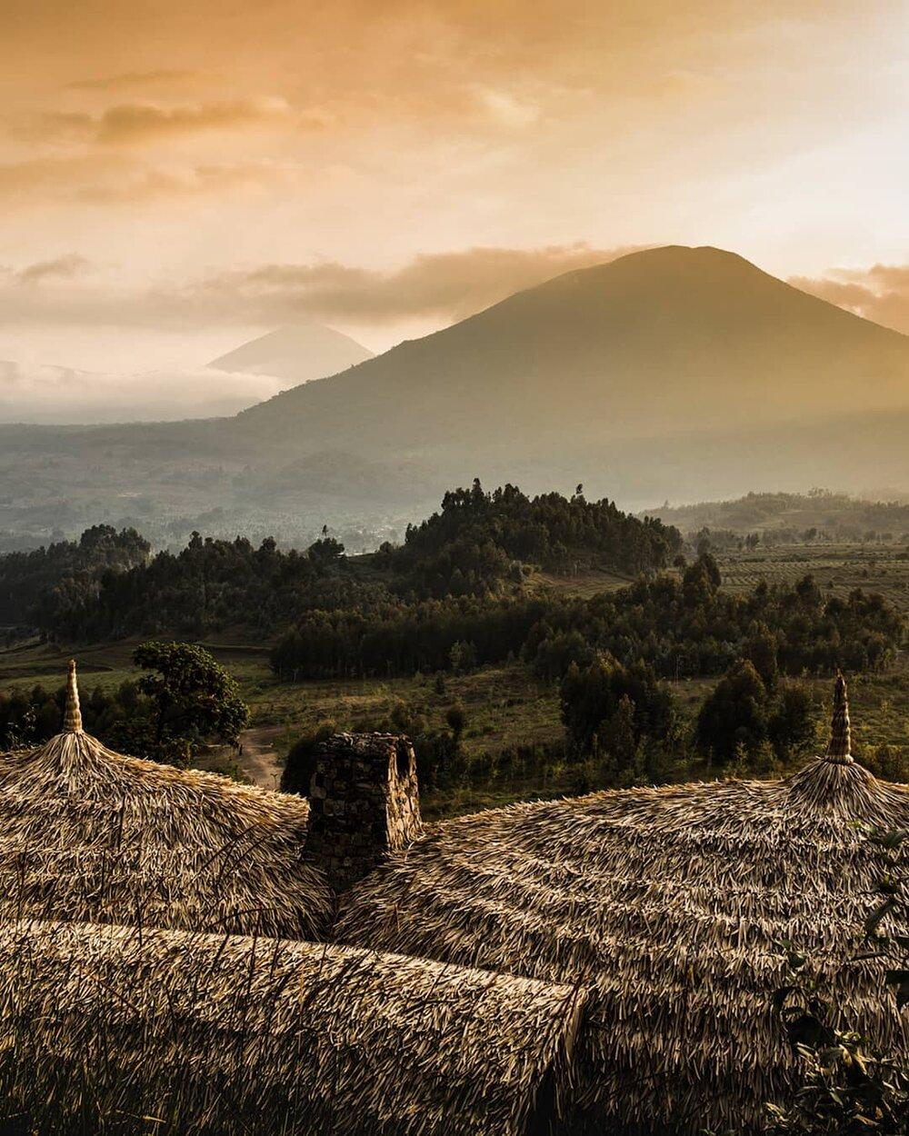A sunset over the Virunga Mountains in Rwanda. Photo: @tom_parker_photographer