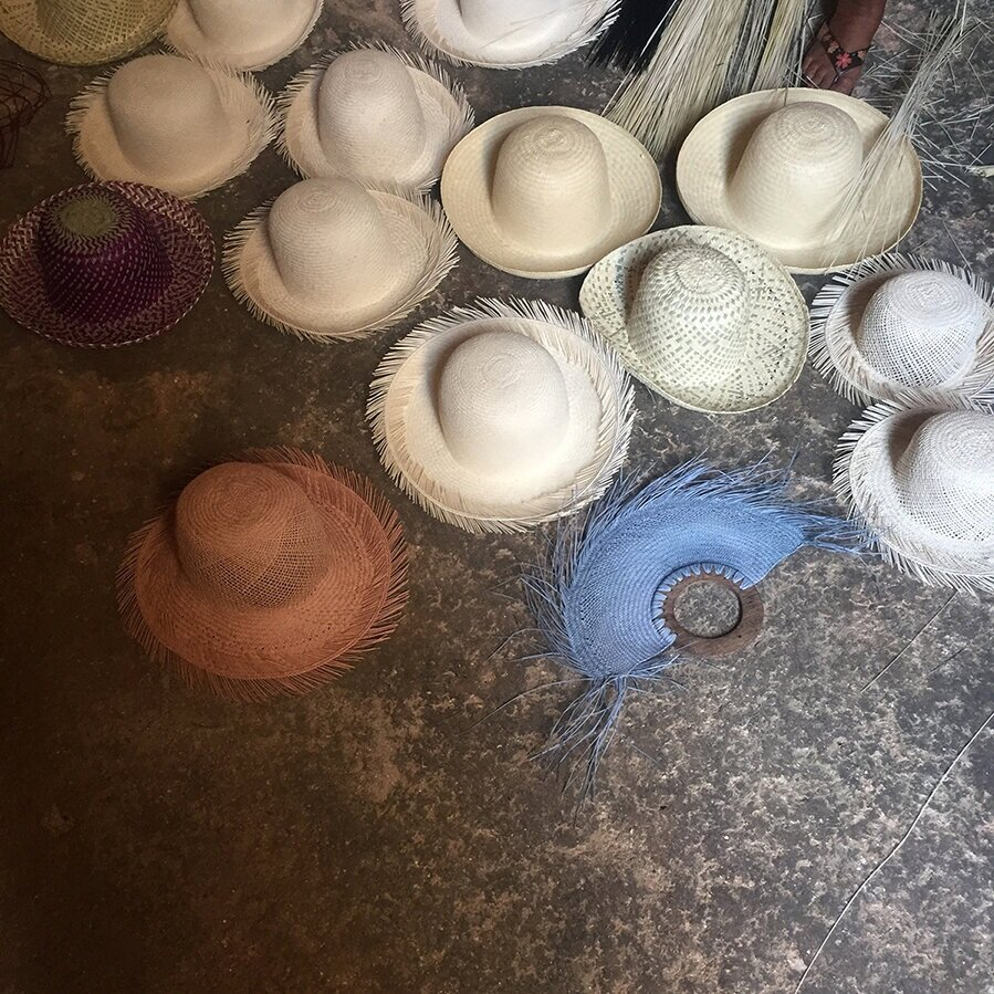 Hats and fans being woven in caves.