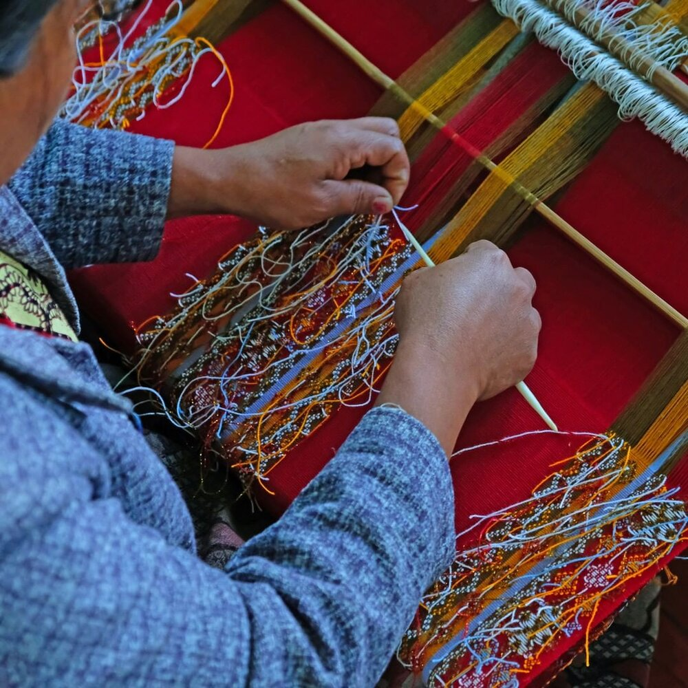 Artisan Hakha with her backstrap loom in Western Myanmar. Image: Turquoise Mountain.
