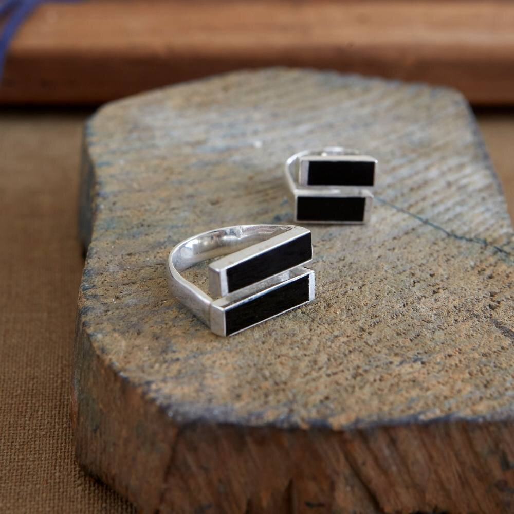 Pictured here:  Equality Silver Ring in Black Agate.