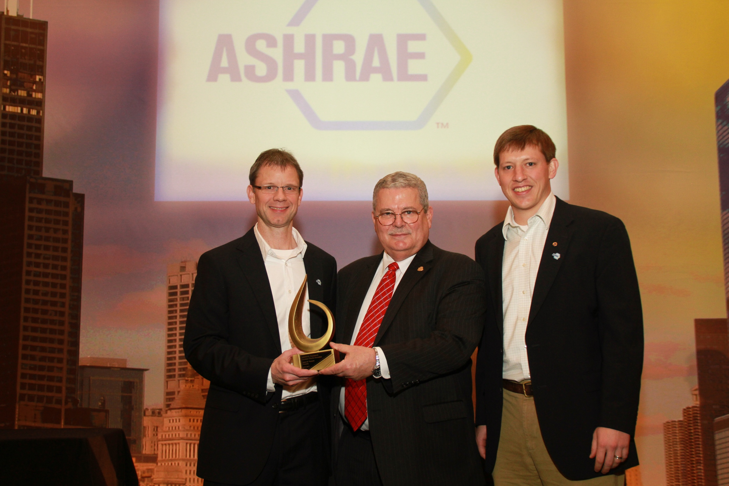 JMP employees accept Gold Circle Award from ASHRAE Research Foundation