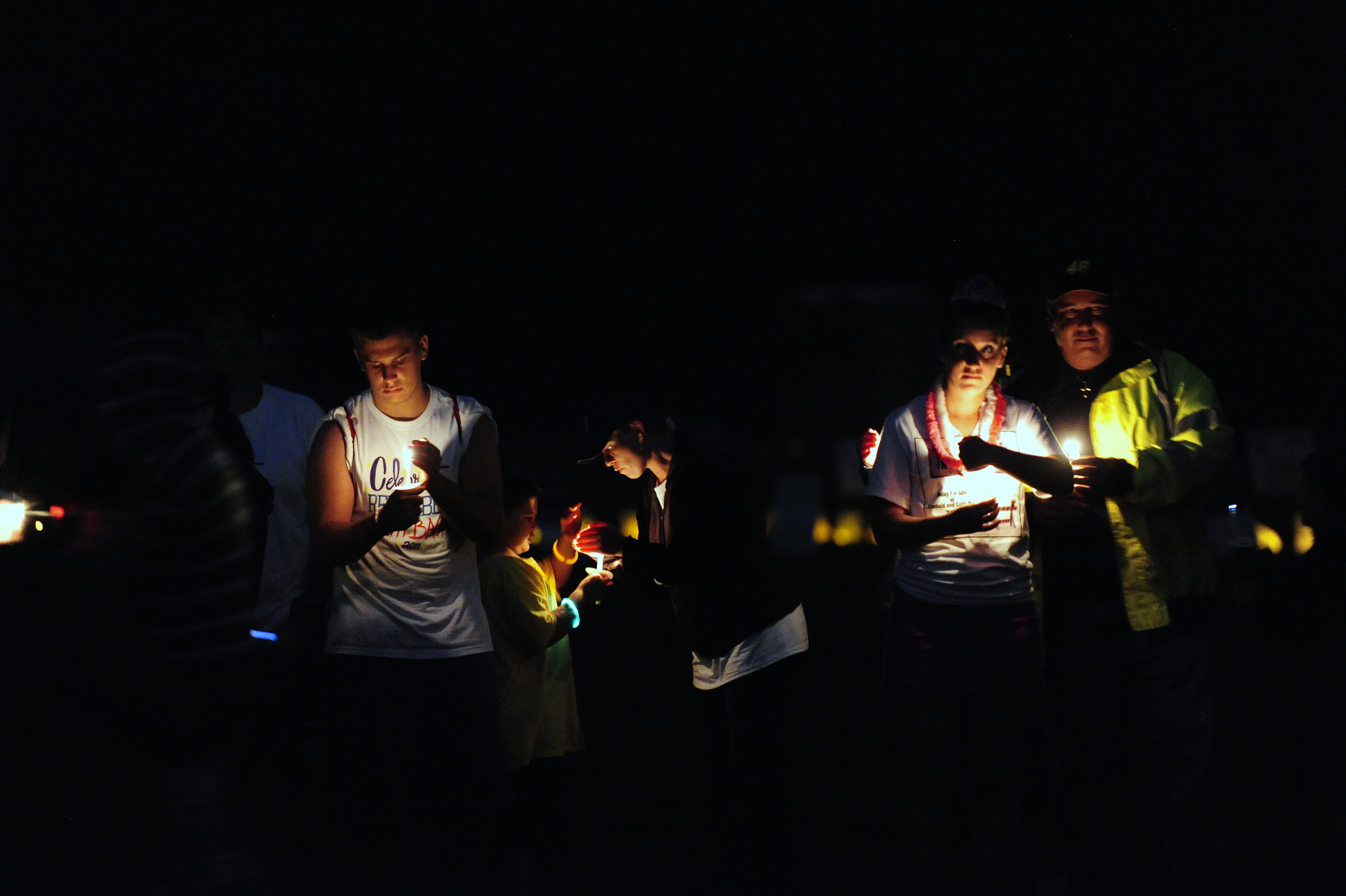 Lighting the Luminaria candles to commemorate those who lost their battles with cancer