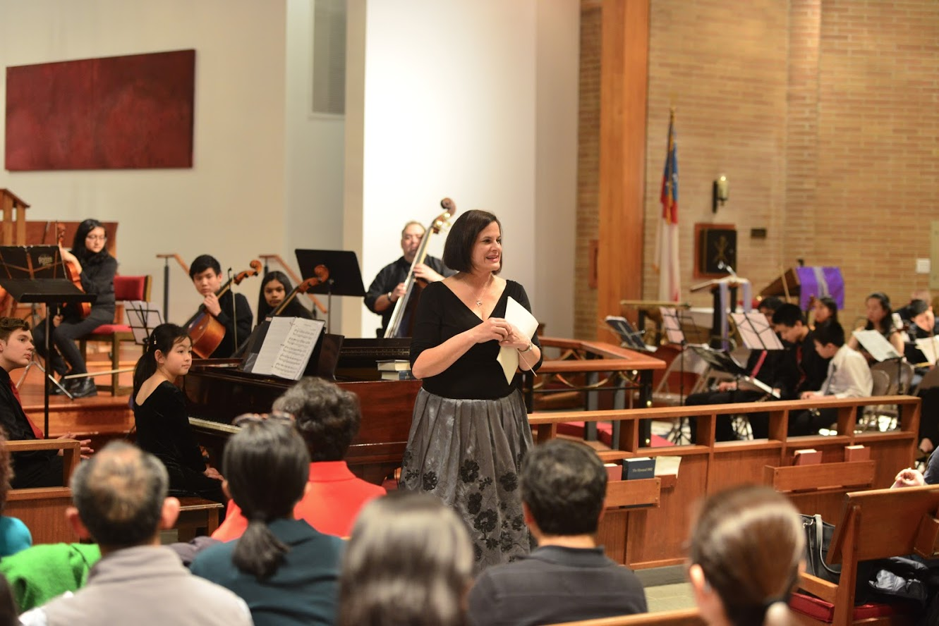 Ms. Gonsky announcing the String Ensemble performances