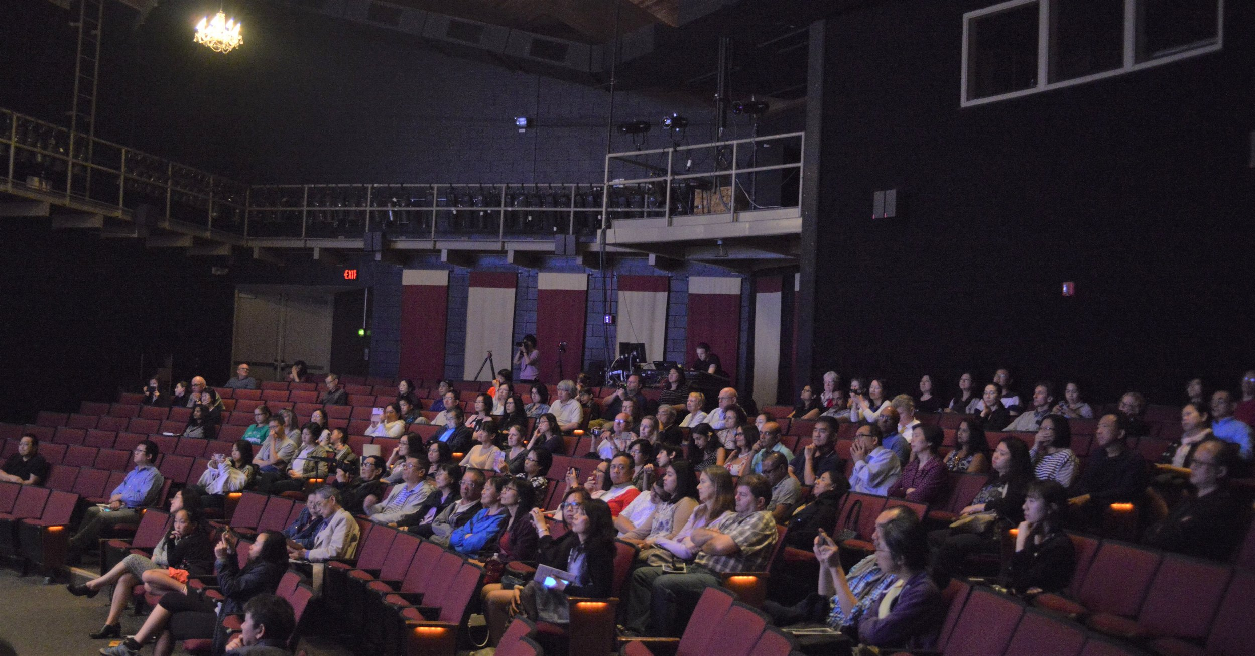 Audience looking on at the performers