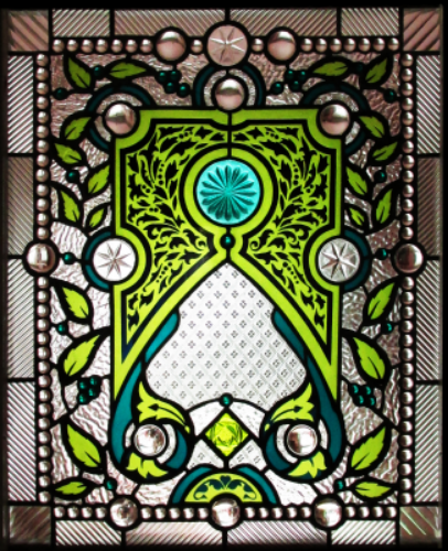 "Stained Glass   20""x 24""   This piece was created with Teal over Green flashed glass, sandblasted, and antique jewels, textured clear glass, and clear glass mill stones."