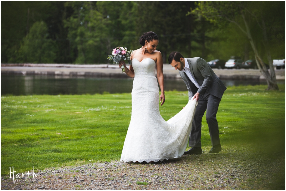 Groom fixing the brides dress - Harth Photography