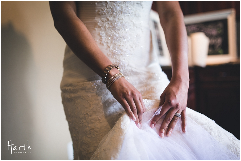 Brides dress and jewelry - Harth Photography