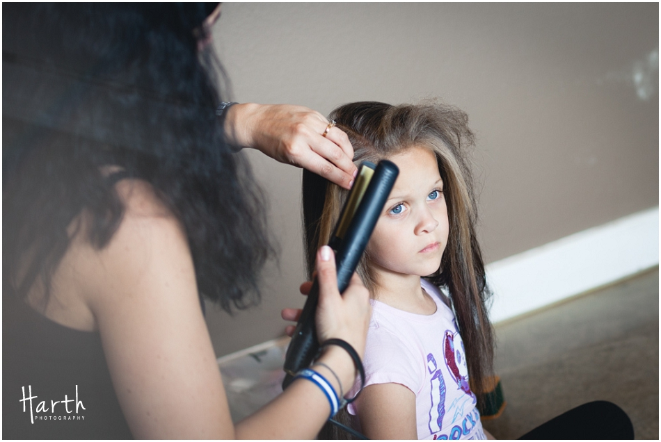 Flower girl getting ready - Harth Photography