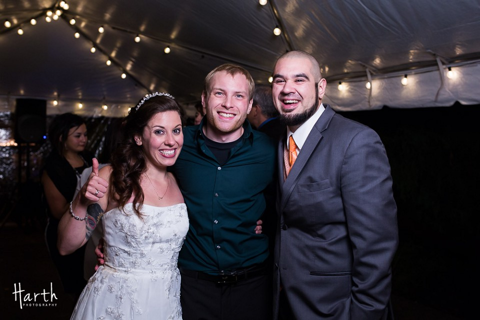 Photographer with bride and groom