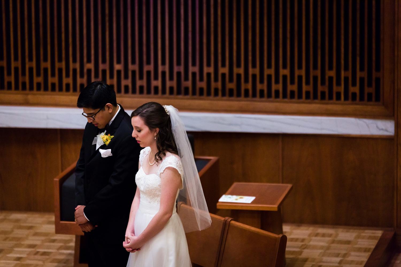 Bride and Groom Pray Wedding Ceremony