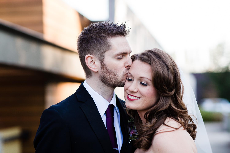 Groom Kisses Bride At Novelty Hill Januik