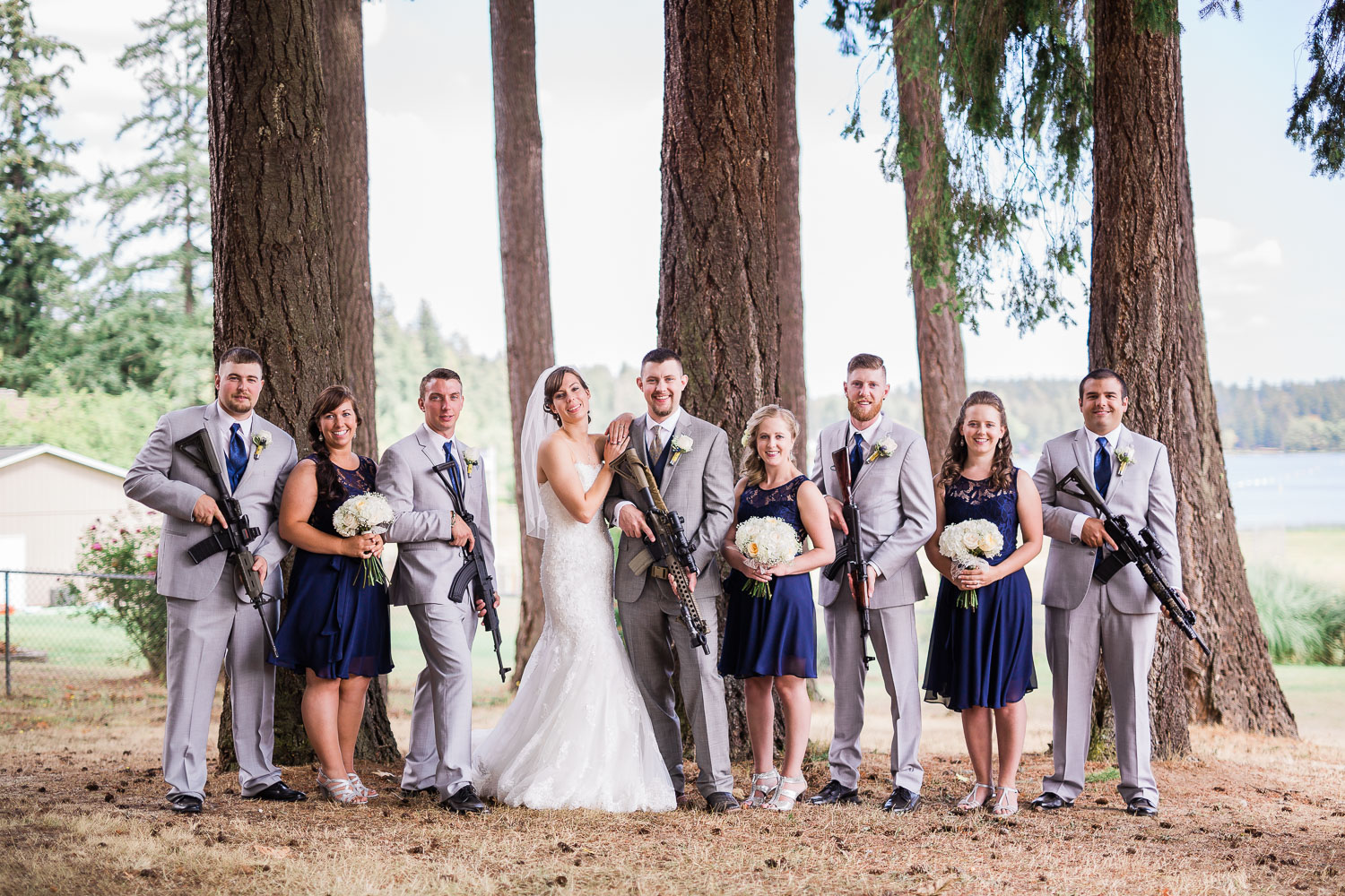Wedding party with rifles
