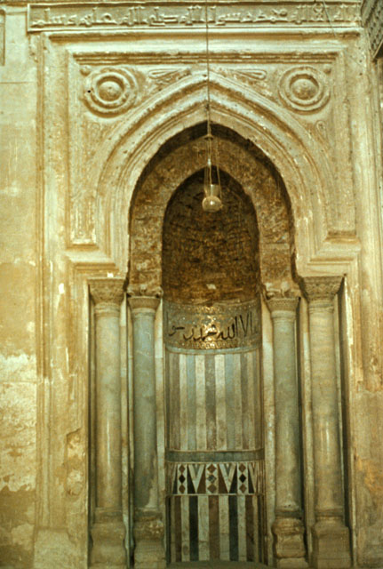 The mihrab. Notice the wood in the hood (the top part of the arch-like enclave).  (Photo from archnet.org)