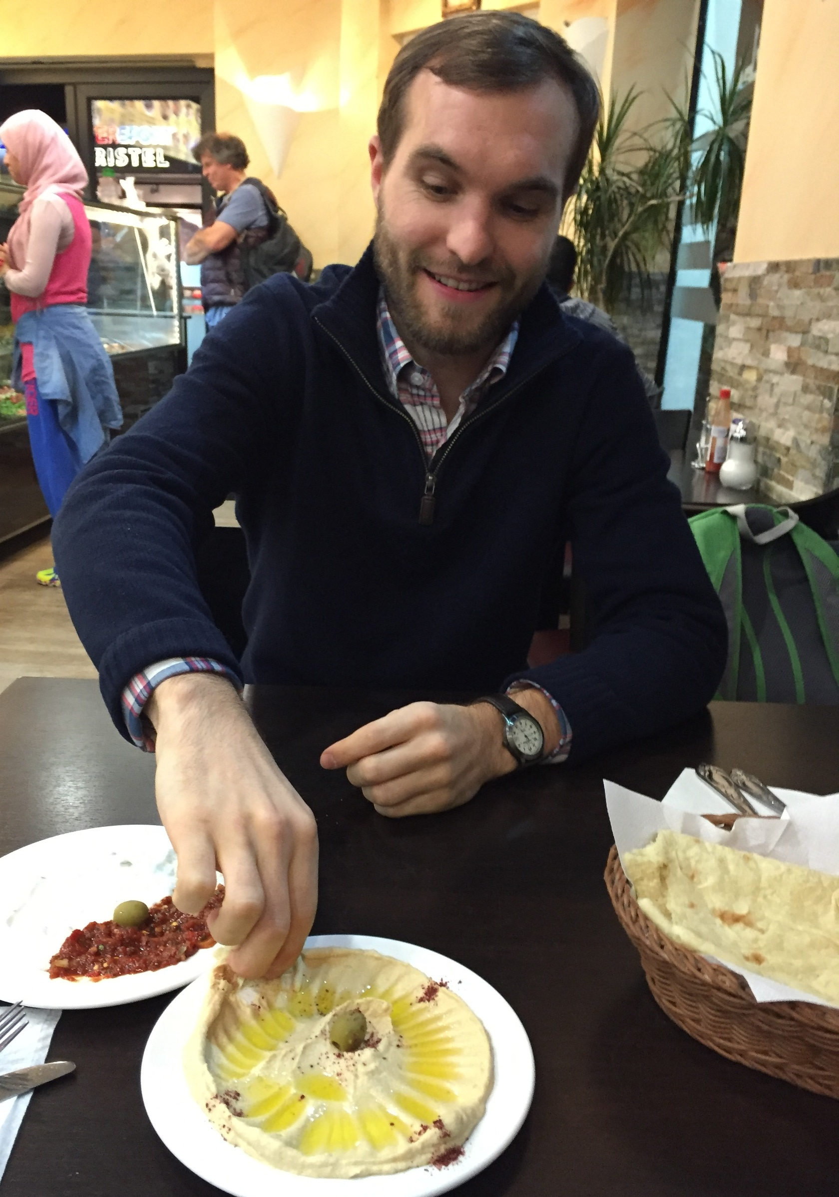 Greg enjoying hummus. (Disclaimer: Picture posted without permission of the subject.)