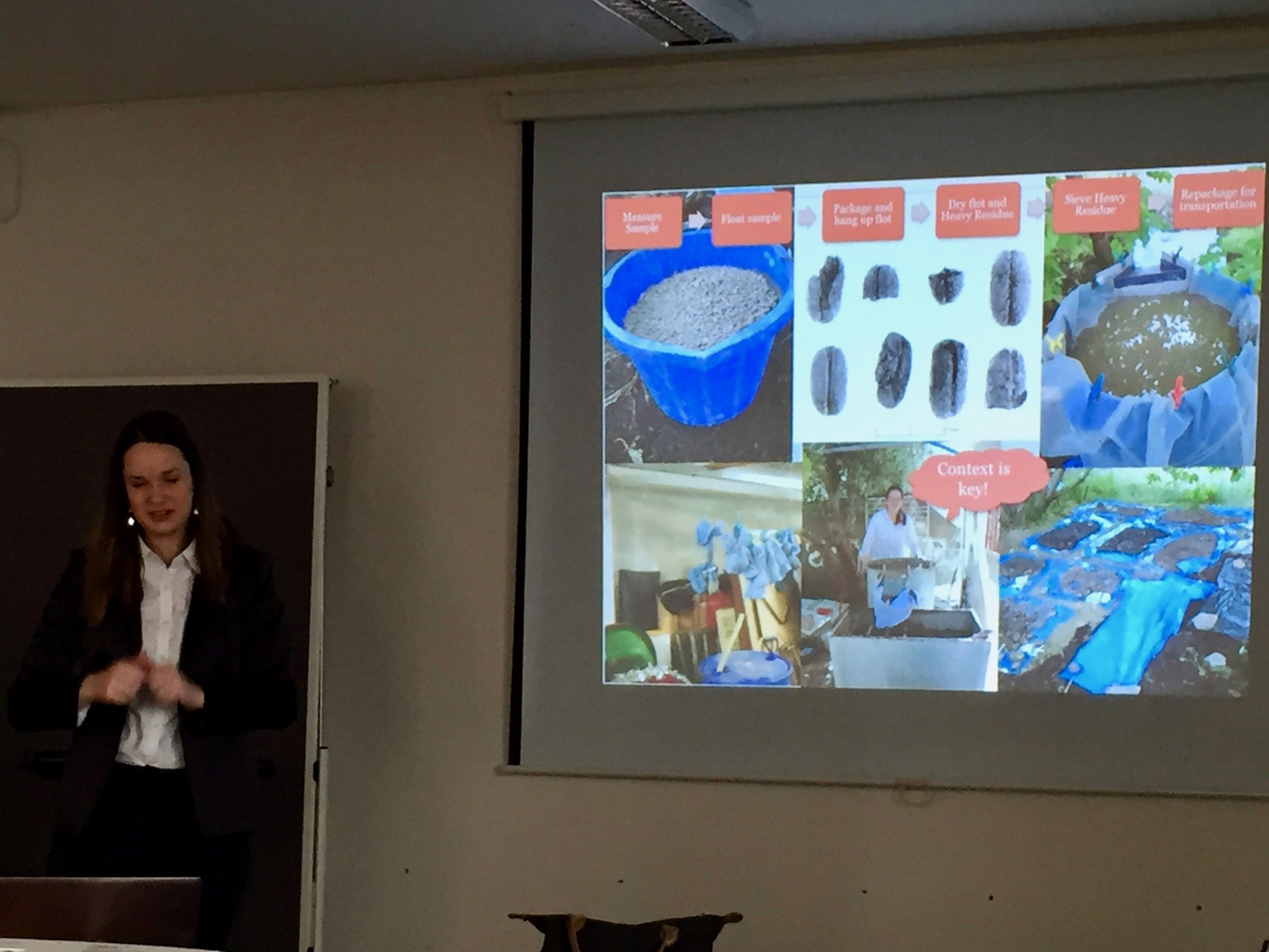 Annette Hansen discussing the process of sorting plant remains at an archeological site.