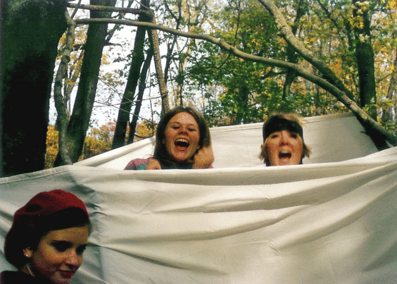 Stephanie and I with our friend Emily. We're in highschool on an art club field trip, and we're jumping around in a handmade teepee in the woods.