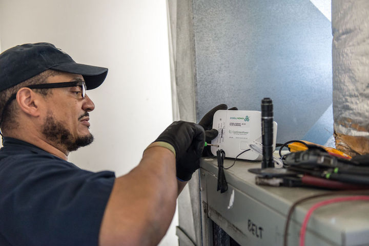 An electrician with the Department of Public Works for Joint Base Anacostia-Bolling installing COOLNOMIX™on April 19th.    Photo taken by Scott Pauley -Joint Base Anacostia-Bolling Public Affairs