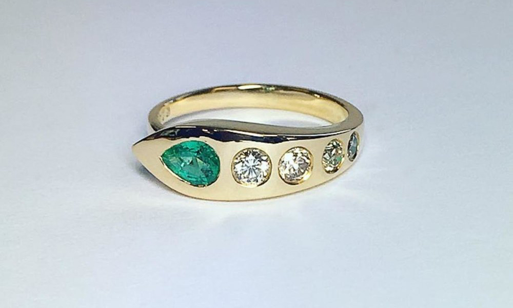 "18 Carat Yellow Gold Emerald & Champagne Diamond Snake Engagement Ring - Our 'Cleopatra' Snake Ring from Regal Collection is hand carved in wax and cast in gold. A very cool and contemporary engagement ring. Snakes are a Victorian symbol of eternal love. Diamonds in Greek is 'Adamas' which translates as 'Invincible' and emerald is known as a stone of love, honesty and integrity. Wonderful qualities for marriage.""This Cleopatra snake ring personally means so much to me. It is hand crafted with love and truly picked me, prompting our marriage proposal. The detail and quality are stunning. It is a stand alone piece. Thanks Rosie. X. Nikki"""