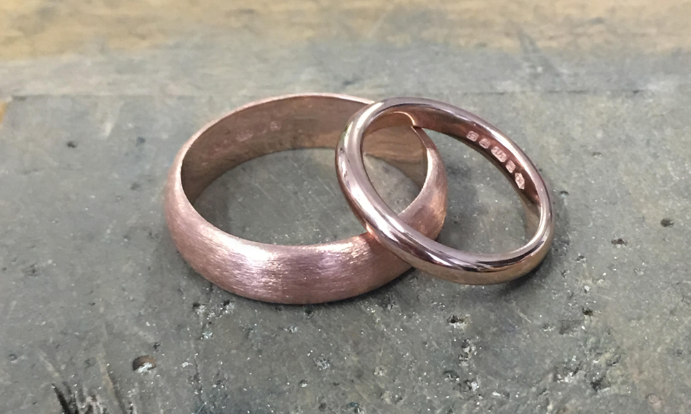 "18 Carat Rose Gold Wedding Bands - His and Hers matching bands. We love this mat finish texture for Him, and polished finished for Her.""Jewellery that opens our hearts. We both knew what our deep emotions were telling us. A timeless set of simple but beautiful wedding bands that meant more to us than anything too luxurious. J Mcfall"""