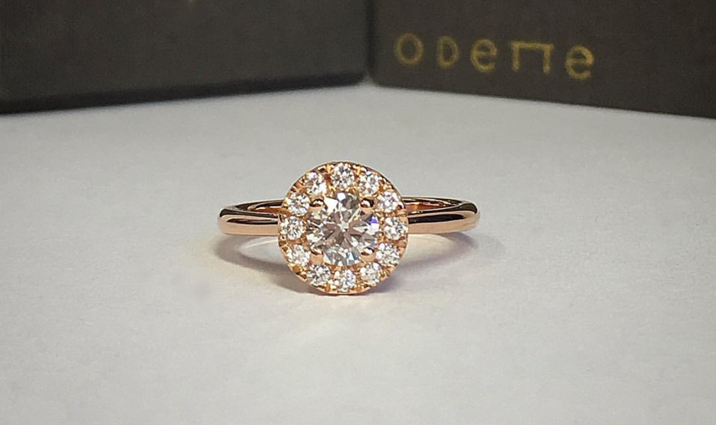 "18 Carat Rose Gold Diamond Halo Engagement Ring - This dreamy engagement ring is set with a very sparkly Si 40 point white diamond and twelve glistening white diamonds in a surrounding halo.""I have absolutely loved my experience working with Rosie to create the perfect engagement ring! I couldn't be happier with the ring and with the personalised service! I would highly recommend Rosie to anyone looking for an amazing engagement ring with a personal touch, and cannot thank her enough! Chris."""