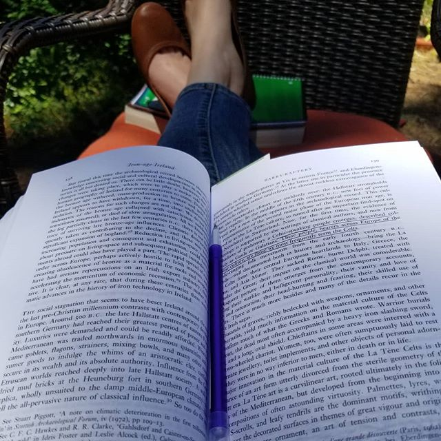 Reading about Iron-age Ireland in our yard surrounded by plants, with a cup of tea. My happy place.