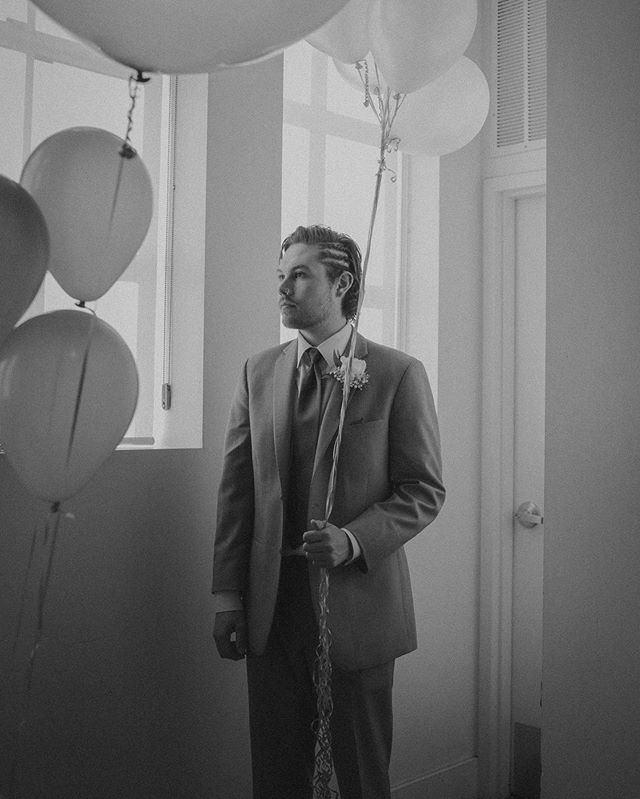 Been too busy with my family and buying plants to create new content  Here's a pic of me with balloons at my sister's wedding  PC @_stratego — #be #blackandwhite #groomsmen #wedding #balloons #cornrows #menshair #mensfashion #filmic #vsco #springfieldcreatives #springfieldphotographer #springfieldtalent #midwestaesthetic #downtownkc #kansascity