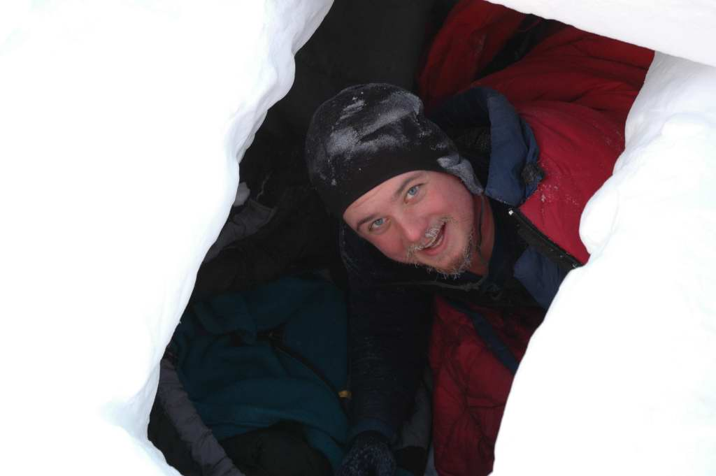 Jon Sprague in snow trench during 'happy camper school.' He slept overnight in it!