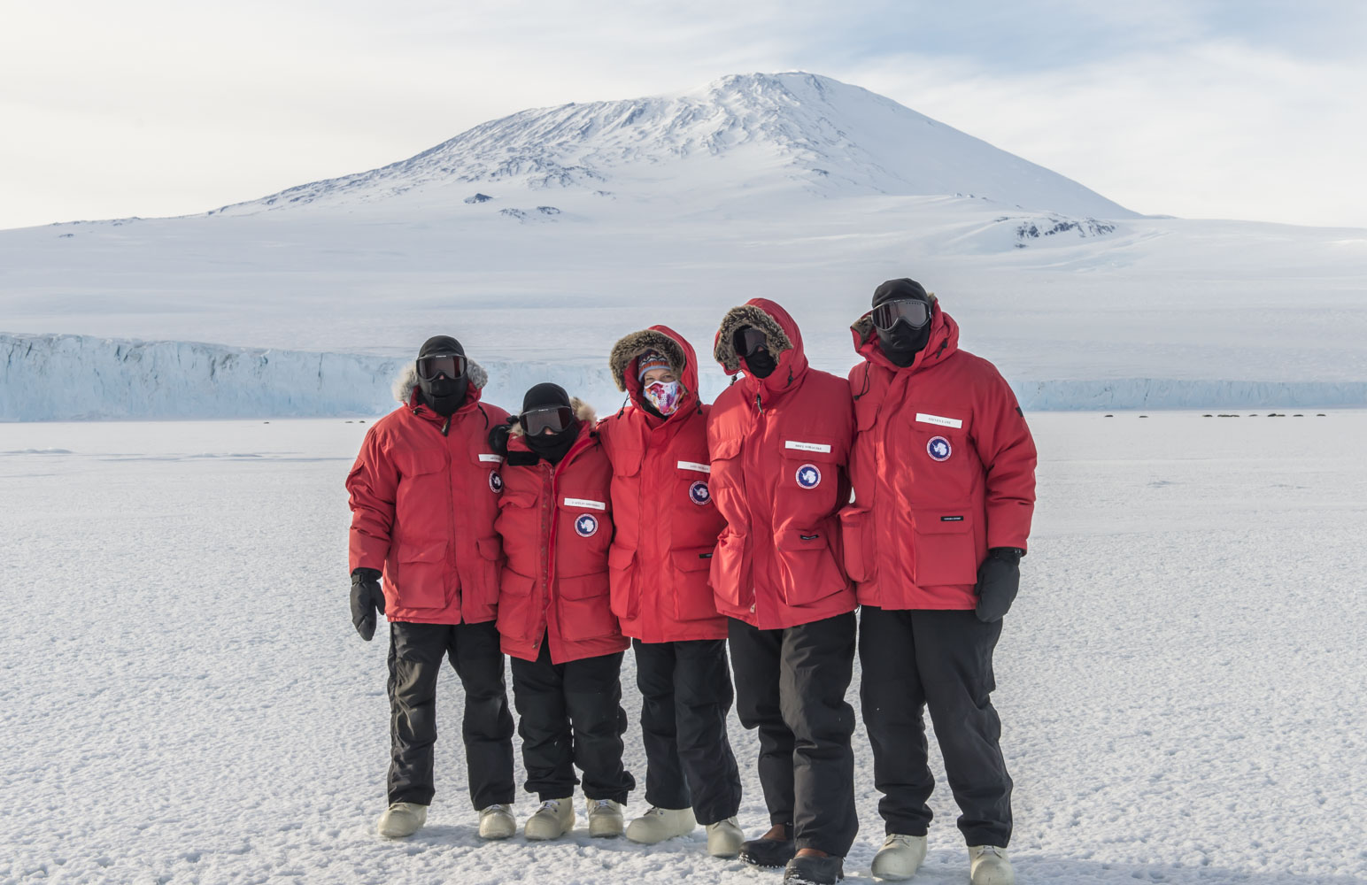 Our team in front of Mt. Erebus (an active volcano on Ross Island, where McMurdo Station is located) during sea ice training.