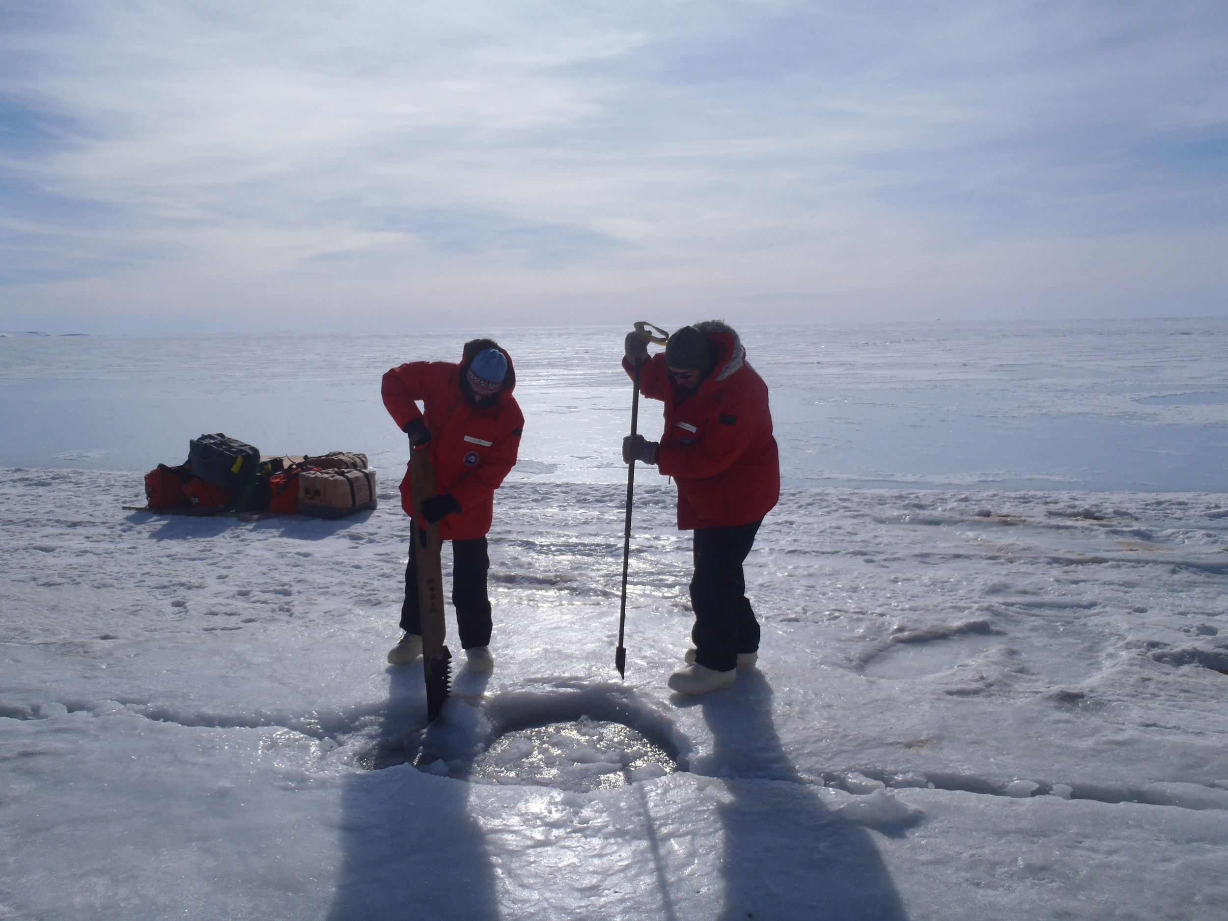Amy and Steve expanding a seal breathing hole so we could use it as a dive entry point.