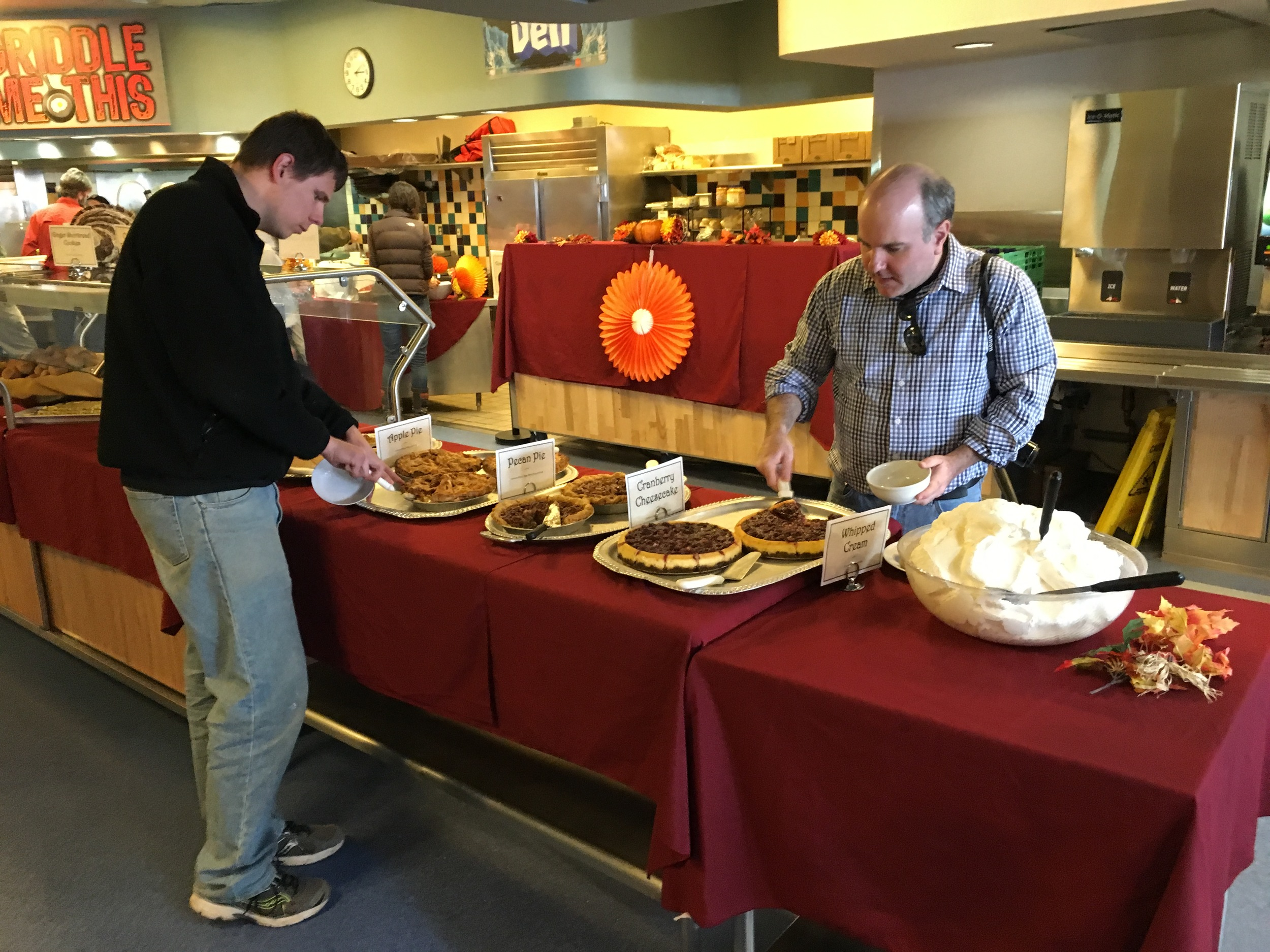 Steve samples the pies at Thanksgiving Dinner in the galley.