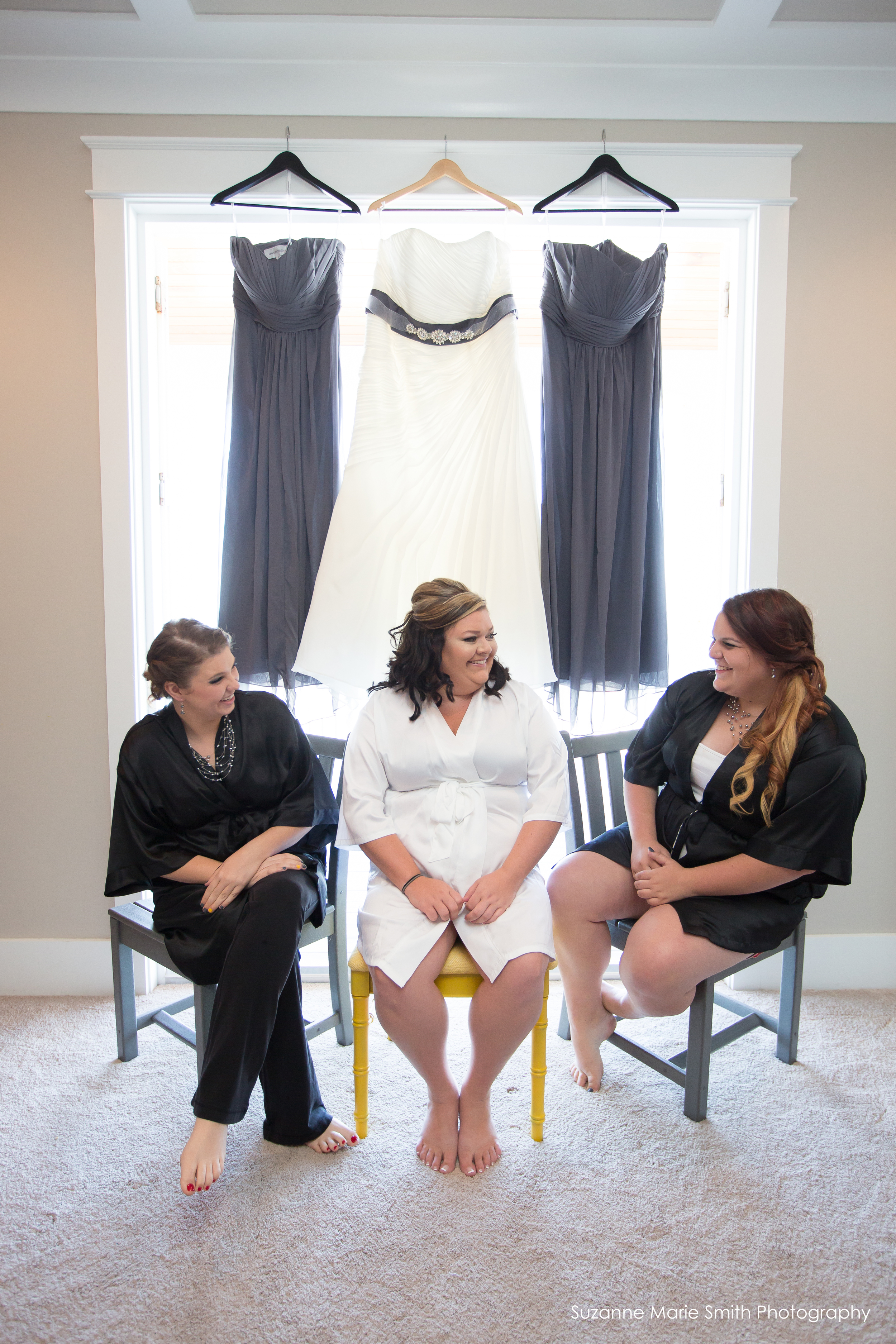 Bride and bridesmaids and their dresses