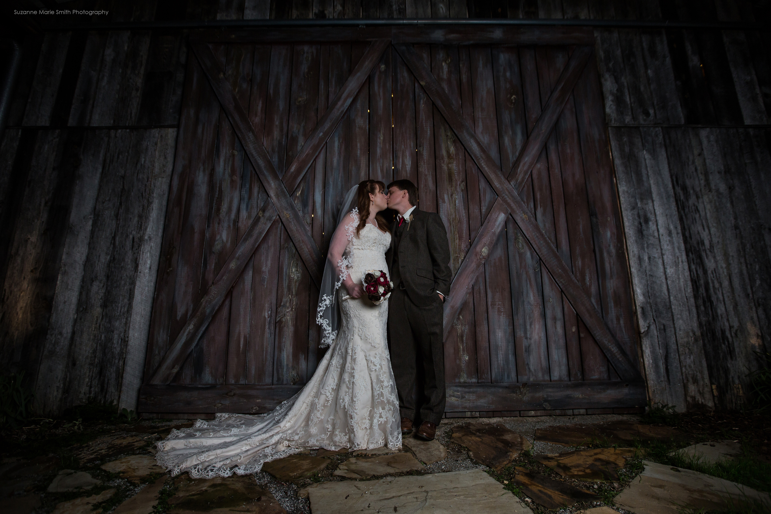 A kiss outside the barn