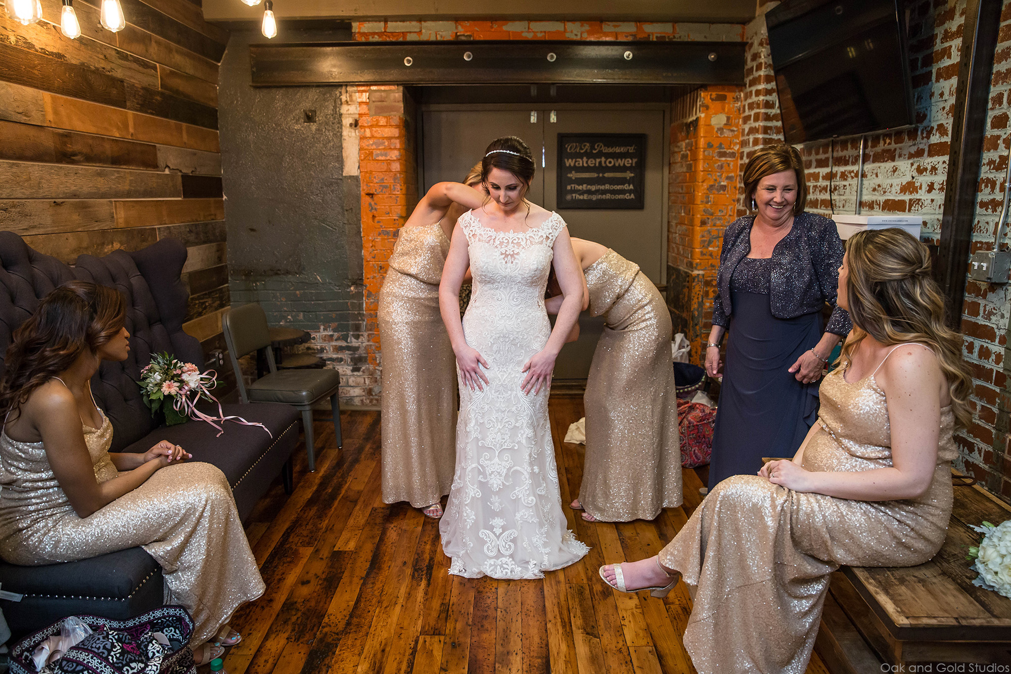 bride putting on dress in the engine room.jpg