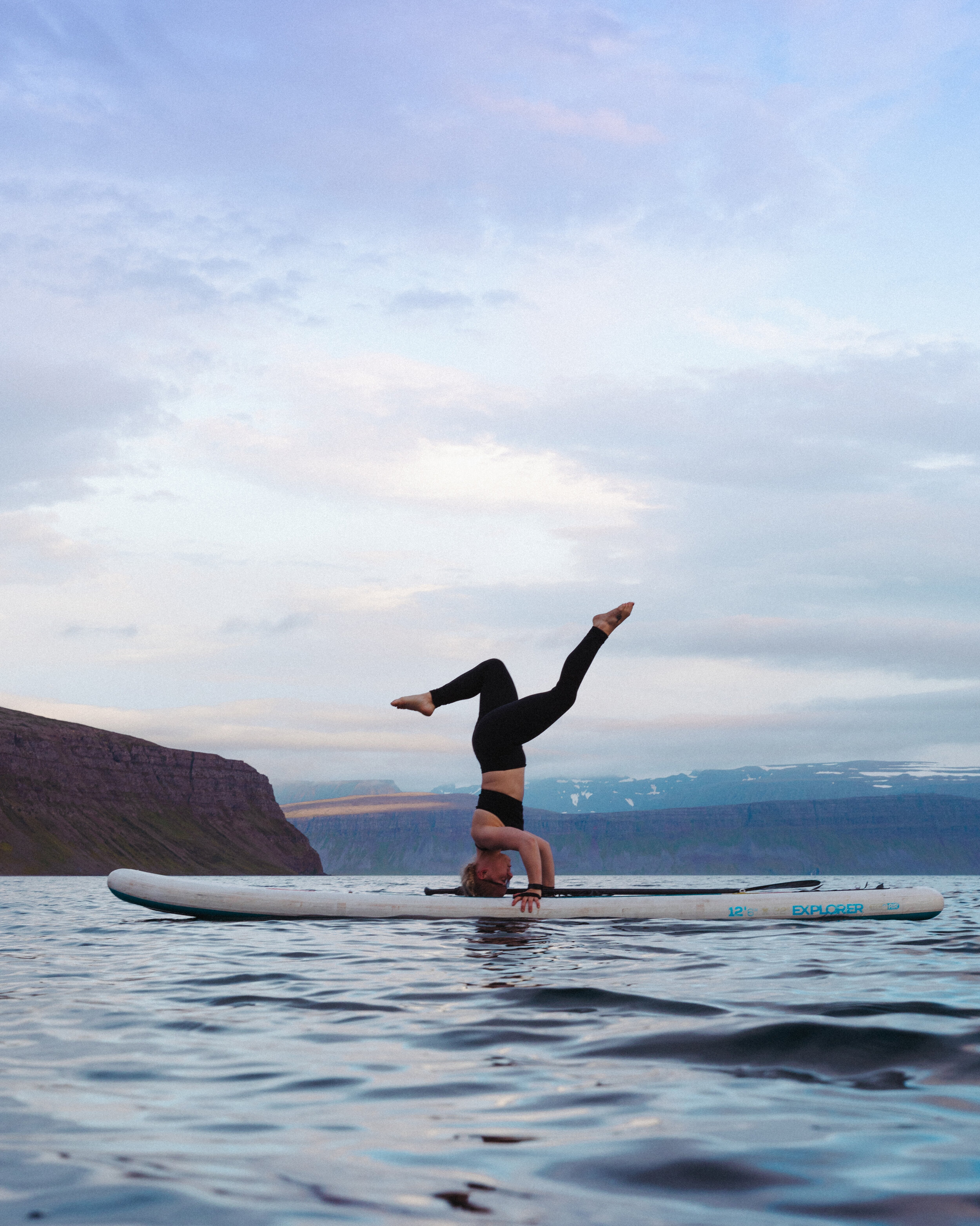 Björk doing a headstand on a paddle board over in Hornstrandir