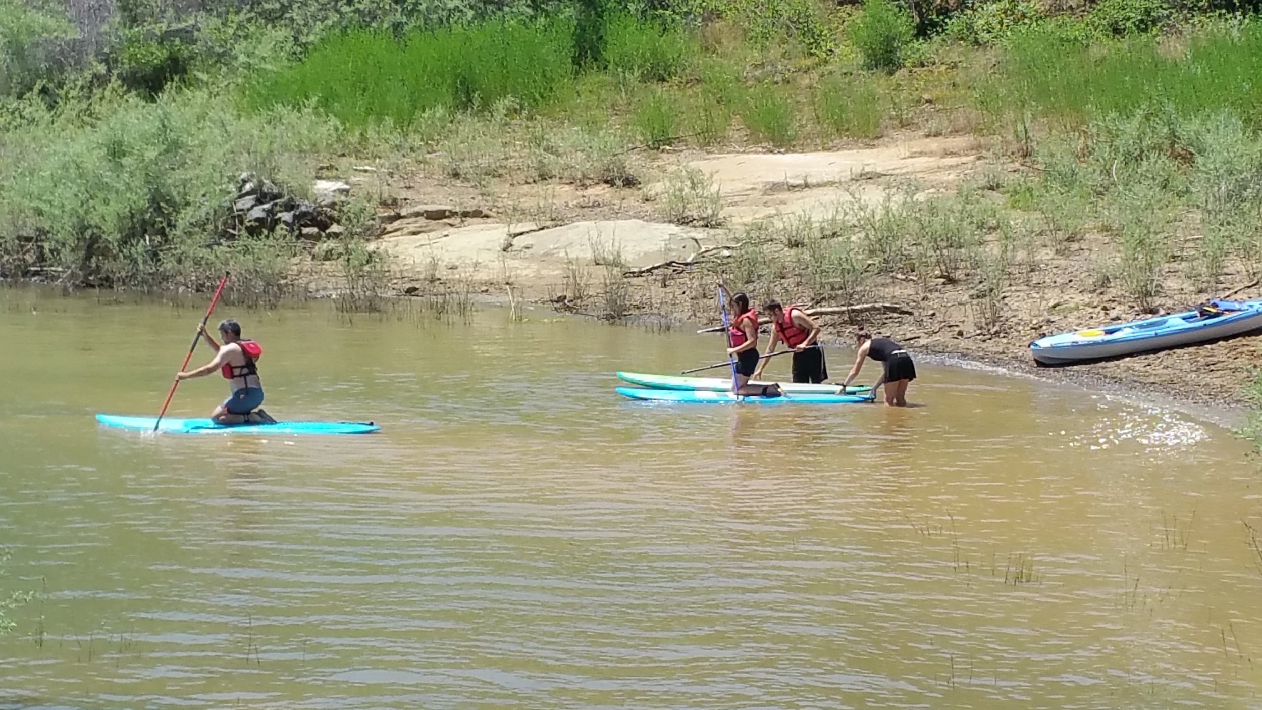 My wife, my brother in law, and me putting the boards in the water.