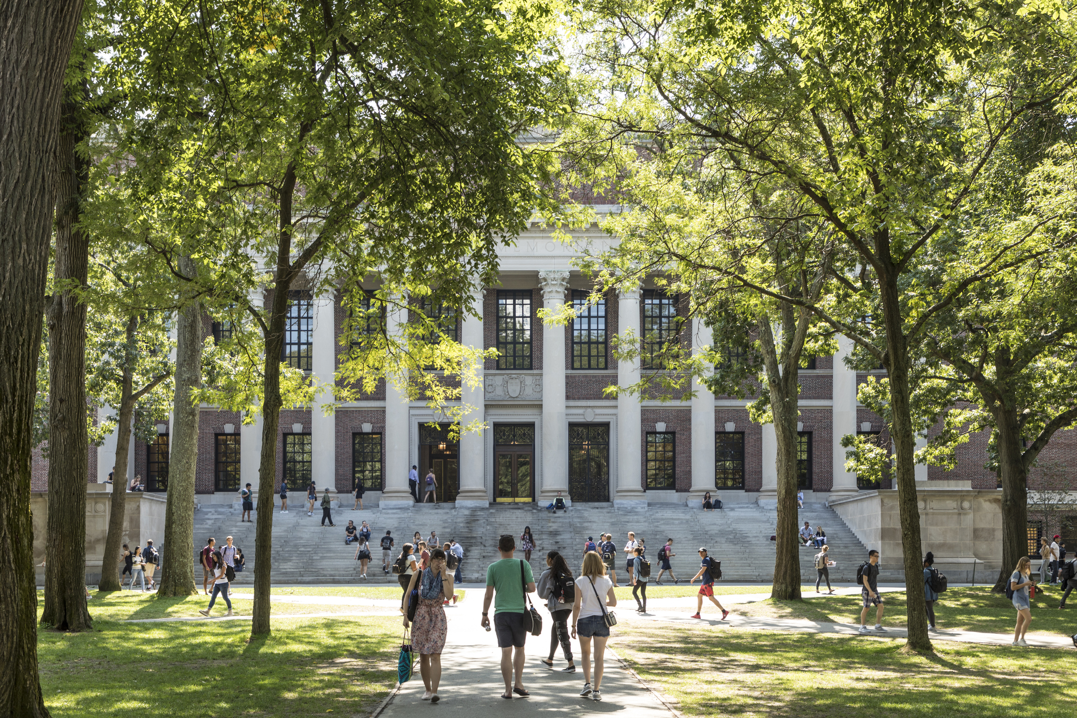 Students-and-tourists-rest-in-lawn-chairs-in-Harvard-Yard,-the-open-old-heart-of-Harvard-University-campus-859884294_2125x1416.jpeg