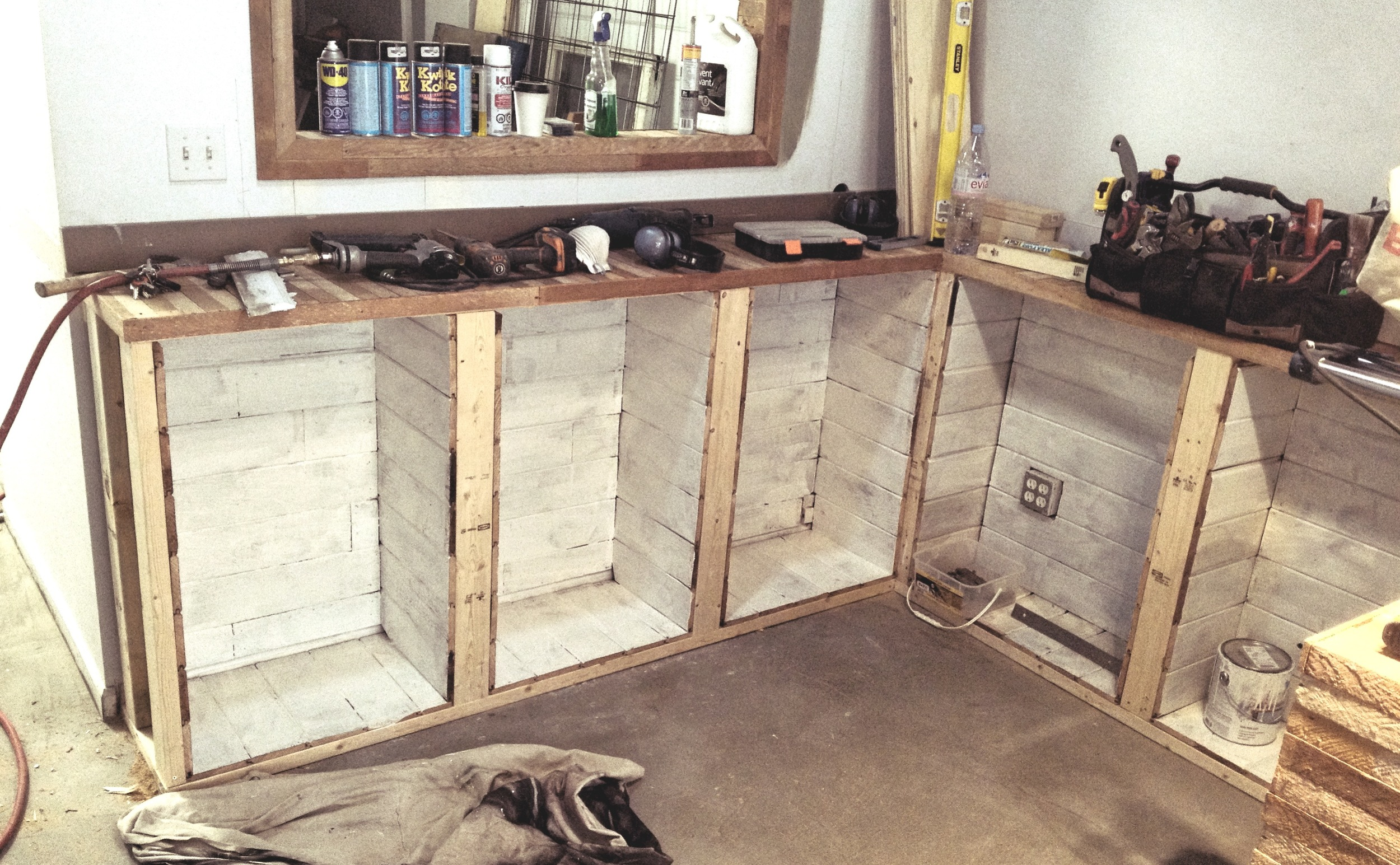 Custom interior shelving hand-crafted from salvaged lath and fencing.