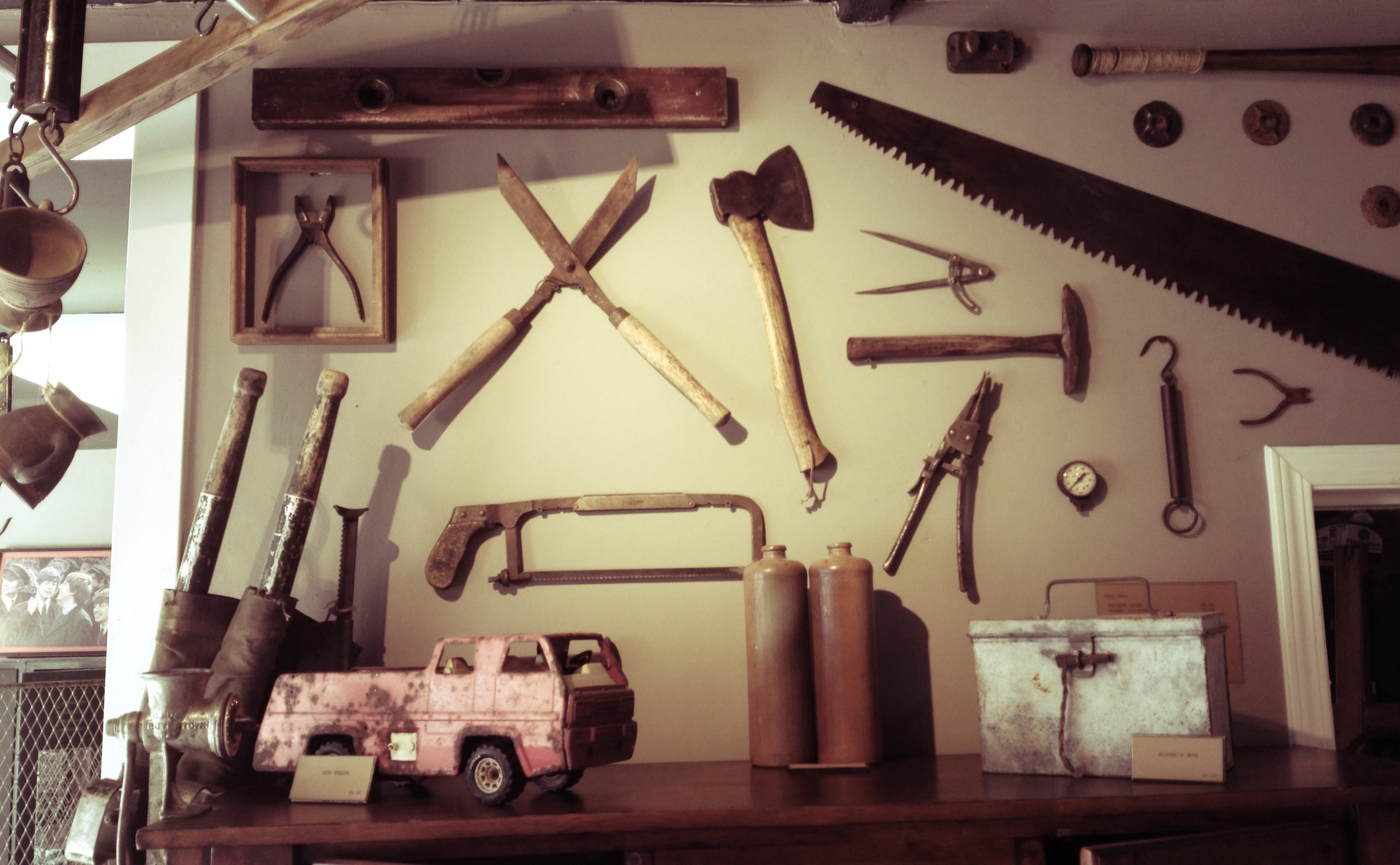 Interior display built from vintage hand tools and saws.