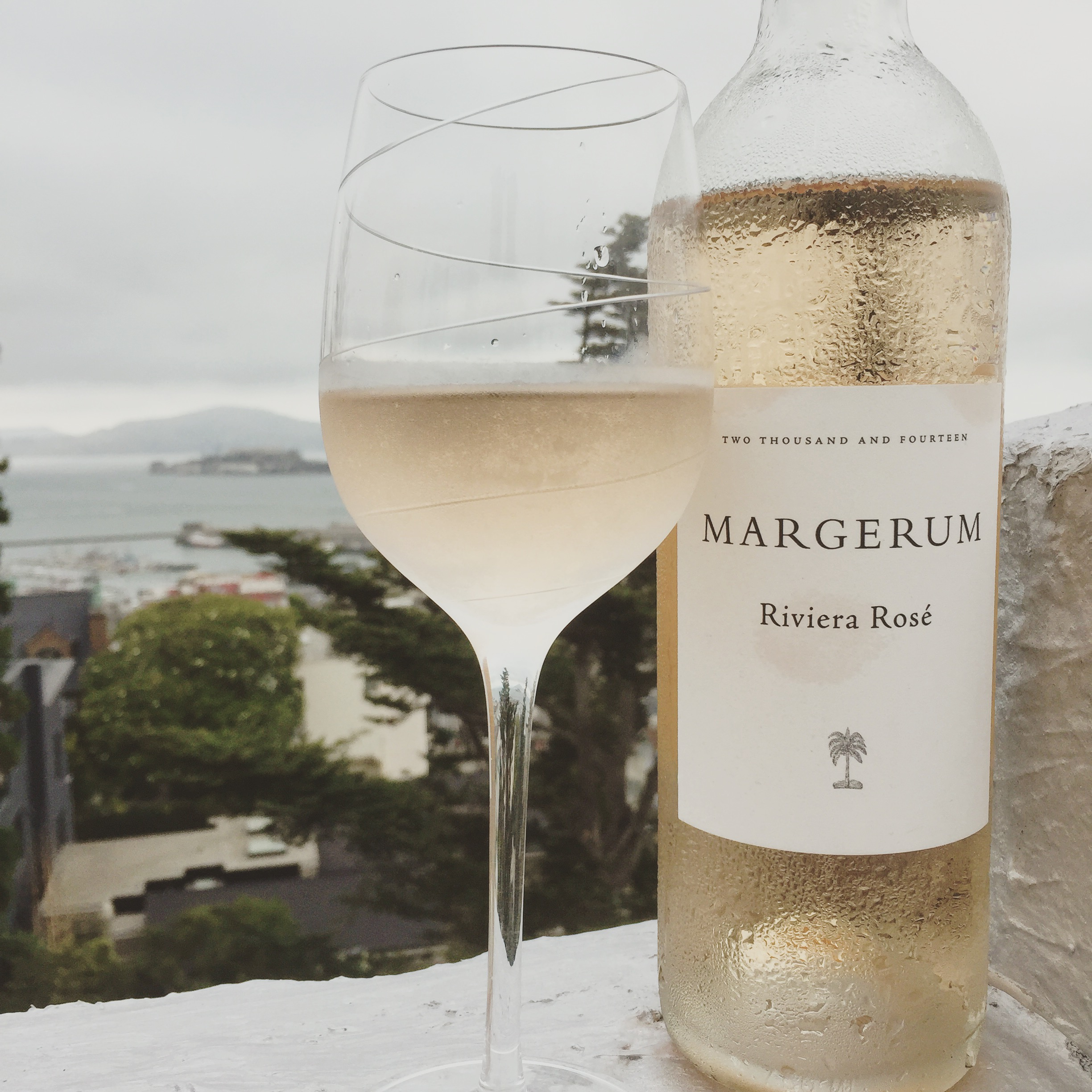 A glass of rosé and a view of Alcatraz from my rooftop - never gets old !