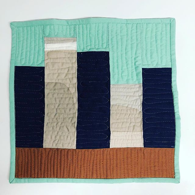 "My first entry for the @curatedquilts mini quilt challenge. The theme was ""House"" and I went with a simple block to show a City Living theme. I don't get to finish a full quilt a lot these days so it was fun to work small and finish a project."