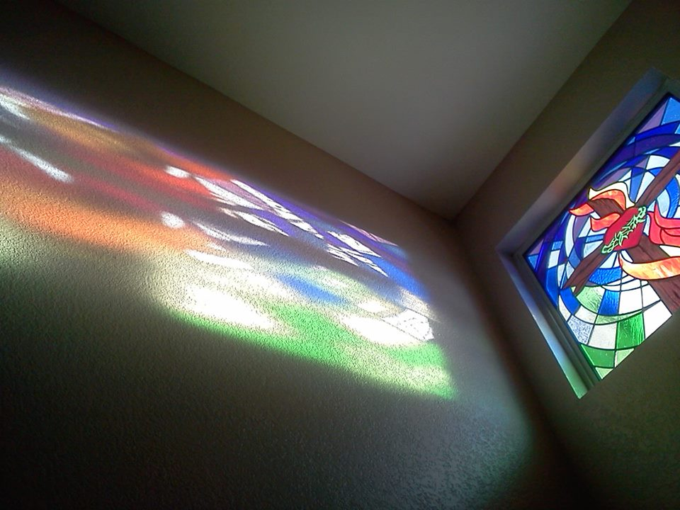 Reflection of Custom Stained Glass Window, cross, heart, crown of thorns