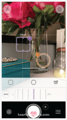 Use the Camera+ app to set focus and exposure separately.