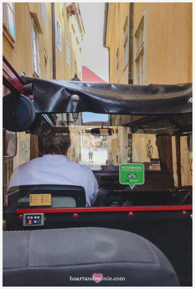 Zipping down the narrowest street in Old Town (a mini Cooper wouldn't fit!)...