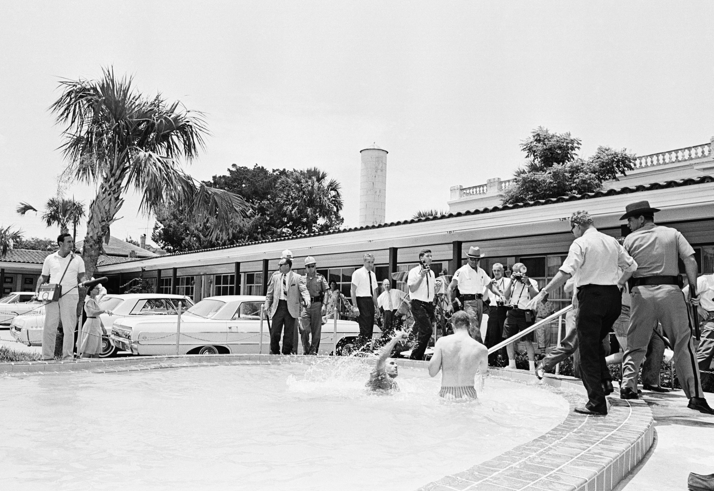 Here he is holding the mic boom at the Monson Motor Lodge in St. Augustine as motel owner Jimmy Brock hysterically runs around the outdoor pool, pouring hydrochloric acid on protesting swimmers. (The Associated Press)